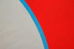 红色,灰色和蓝色上色了丙烯酸树脂地板背景 免版税库存图片