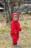 红色总体的小男孩 免版税库存图片
