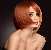 红色头发。 优质图象。 免版税库存图片