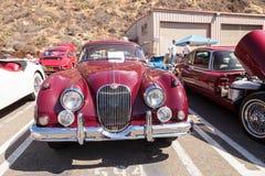 红色1958年捷豹汽车XK 150 FHC 免版税库存照片