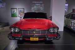 红色1958年普利茅斯愤怒特技汽车 图库摄影