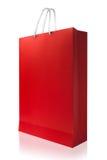 红色购物袋,隔绝与在白色backgroun的裁减路线 图库摄影