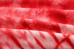 红色绒头织物领带染料 库存照片
