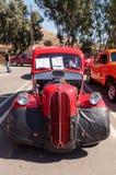 红色1950年福特Anglia小轿车 图库摄影