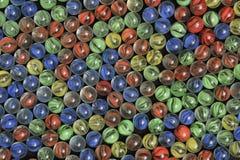 红色黄绿色和蓝色大理石-图象2 图库摄影
