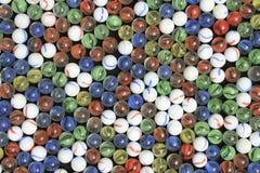 红色黄绿色和蓝色大理石 免版税库存照片