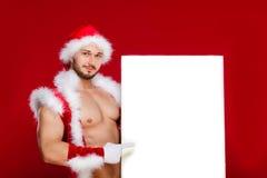 红色bac的非常肌肉被镀青铜的英俊的性感的圣诞老人 库存照片