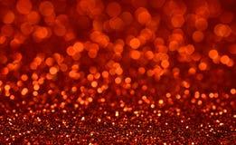 红色Bokeh闪烁背景 免版税图库摄影