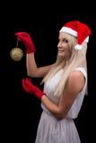 红色Cristmas圣诞老人帽子的女孩 免版税图库摄影