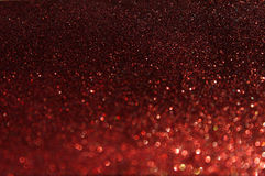 红色defocused光背景。抽象bokeh光。红色闪烁背景。 免版税库存照片