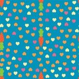 红萝卜和心脏无缝的样式 免版税库存图片