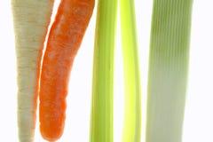 红萝卜在透明白色的芹菜韭葱 库存照片