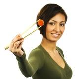 红萝卜筷子拿着片式妇女新 免版税库存照片