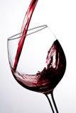 红葡萄酒倾吐 库存照片