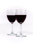 红葡萄酒在两块玻璃中重叠 免版税库存照片