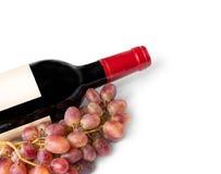 红葡萄酒瓶背景 免版税库存照片