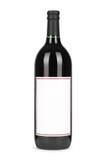 红葡萄酒瓶,当纸空白的标签被隔绝在白色 免版税图库摄影