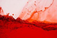 红葡萄酒飞溅-接近的抽象背景 库存图片