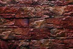红褐色的石墙纹理背景自然颜色 免版税库存图片