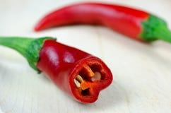 红辣椒和一个被切的部分 免版税库存照片