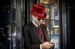 红顶帽子的门房 免版税库存图片