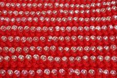 红颜色被编织的织品与小珠装饰的  免版税图库摄影