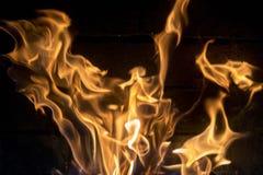 红黄色火特写镜头 查出的背景黑色火 库存图片
