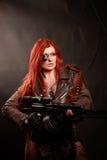 年轻红头发人军事女孩 库存图片