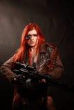 年轻红头发人军事女孩 免版税库存照片