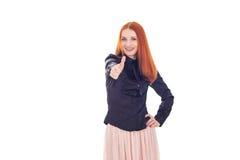 红头发人妇女显示超级的标志 免版税库存图片