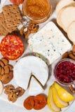 纤巧乳酪和快餐,垂直的构成的分类 免版税图库摄影