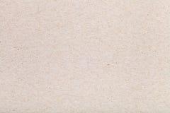 从纤维状纸板纸的背景 免版税库存照片