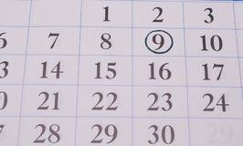 约会在日历的一个黑圈子 库存照片