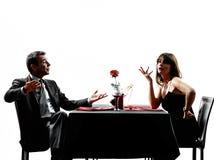 约会晚餐争执剪影的夫妇恋人 免版税图库摄影