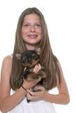年轻约克夏狗和孩子 库存图片