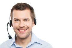 纯熟男性操作员在耳机工作 免版税库存照片
