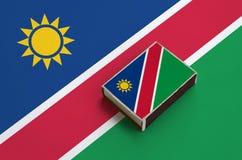 纳米比亚旗子在一面大旗子说谎的火柴盒被生动描述 库存照片