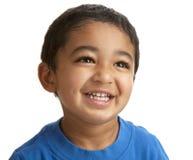 纵向微笑的小孩 免版税库存照片