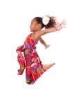 纵向新非洲亚洲女孩跳 免版税库存照片