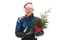 纵向有圣诞树的马达骑自行车的人 库存图片