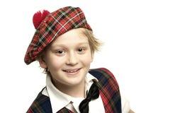 纵向男小学生苏格兰人 库存照片