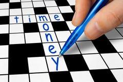 纵横填字谜-时间和金钱 免版税图库摄影