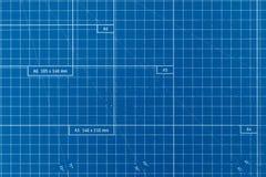 纸切口方格的委员会蓝色色的表面 库存图片