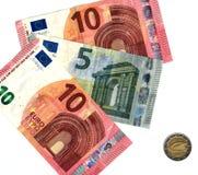 纸币和硬币 免版税图库摄影