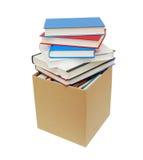 纸板箱和书 免版税库存照片