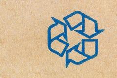 纸板纹理与回收标志 免版税库存图片