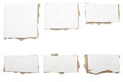 纸板被剥去的白色片断,没有阴影的汇集 库存照片