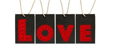 纸标记与罗斯字母表的标记在爱词 免版税库存图片
