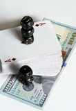 纸牌、模子和美元 免版税图库摄影