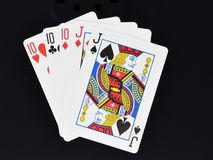 纸牌游戏手三张相同和二张相同的牌 免版税库存图片